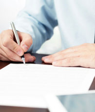 Man signing professional license